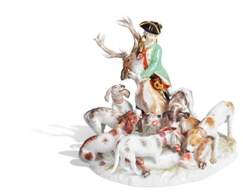 Охотник с собаками и оленем