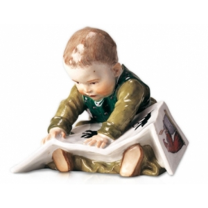 Child sitting with book, Coloured, without gold, H 10 cm